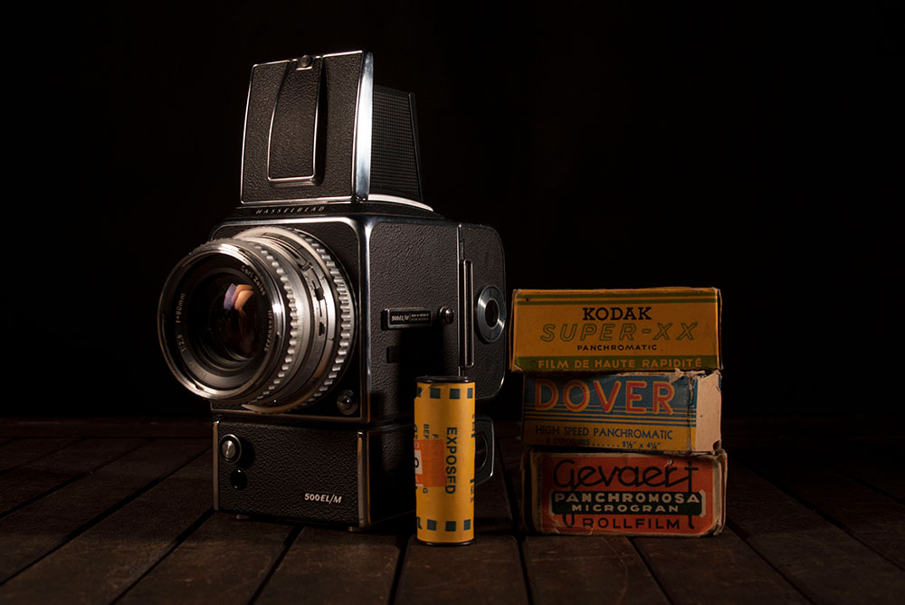 Antique Cameras Still Life with Film and Packaging