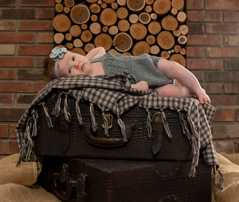 Exquisite Newborn Photography in Alluring and Warm Rustic Fireplace